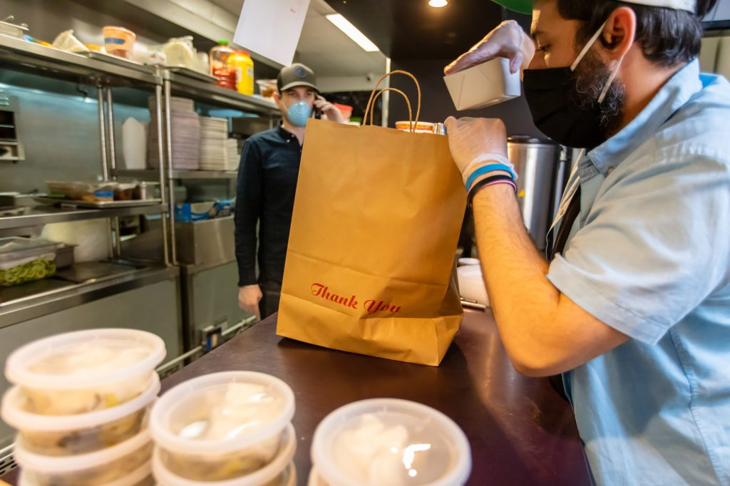Carryout food packaged by worker