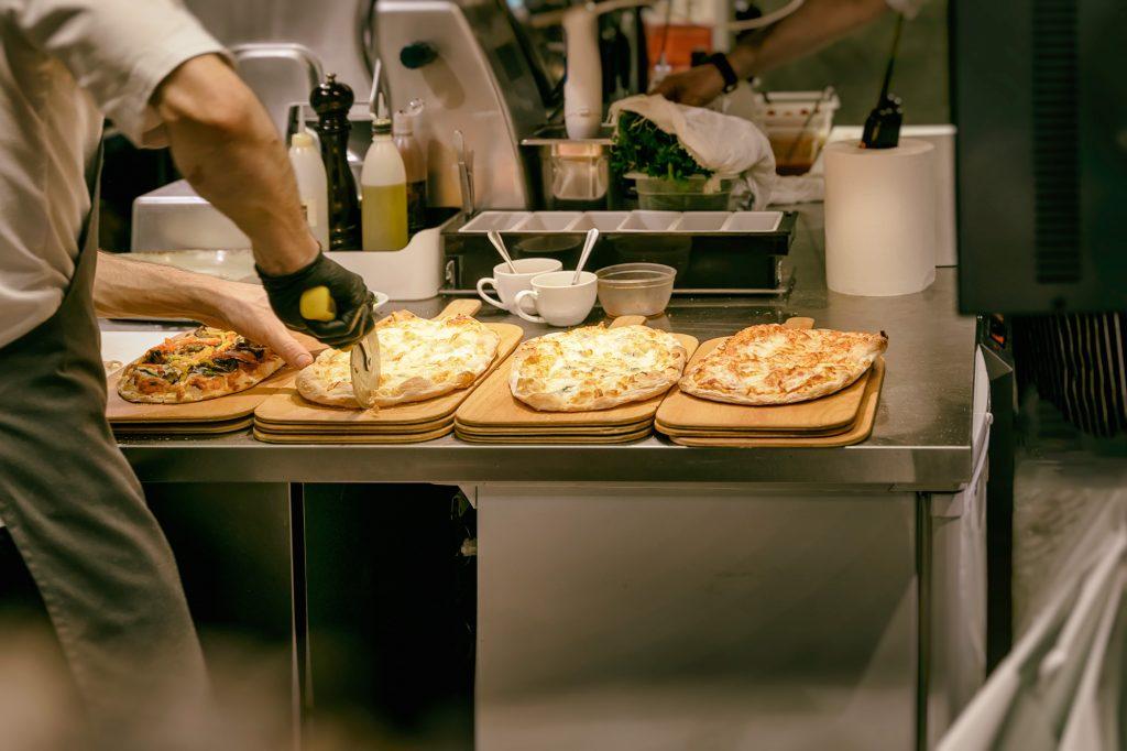 Cutting Pizza Photo